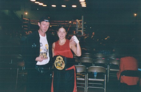 "Boxing trainer Michael ""Coach Mike"" Kozlowski with his first USA National women Golden Gloves Champion- Yelena Binder."