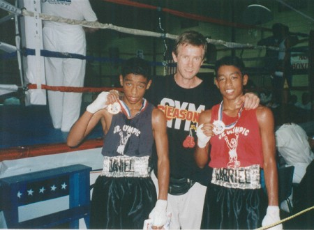 "2002 National Junior Olympics PAL Champion Daniel Castillo, and Silver Medalist - Gabriel Castillo with trainer Boxing trainer Michael ""Coach Mike"" Kozlowski."