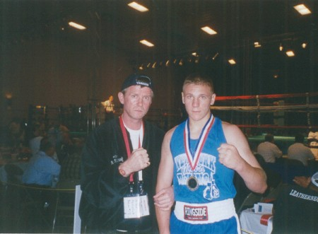 "Boxing trainer Michael ""Coach Mike"" Kozlowski with his USA Junior Olympic Champion Sasha Mamoshuk."