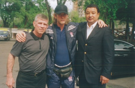 "From left to right: Victor Demyanenko, Boxing trainer Michael ""Coach Mike"" Kozlowski, Serik Konakbaev"