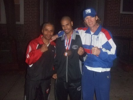 "Left to right: Robert Pagan, Shemuel Pagan, Boxing trainer Michael ""Coach Mike"" Kozlowski"