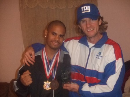 "Boxing trainer Michael ""Coach Mike"" Kozlowski with Shemuel Pagan and the Outstanding Boxer trophy"