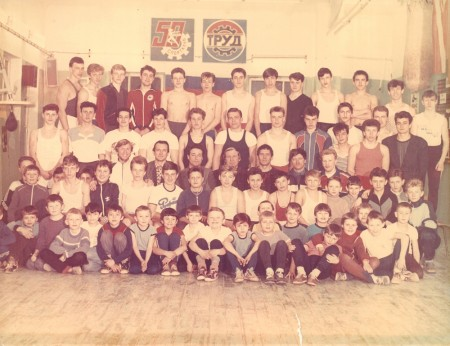 "1991. Russia. Boxing trainer Michael ""Coach Mike"" Kozlowski with his students. In the second row fifth from the right, sits Yury Belskiy in light grey color sweater covering"