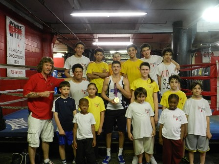 "2012 Olympic Champion Luke Campbell with Boxing trainer Michael ""Coach Mike"" Kozlowski's young prospects."