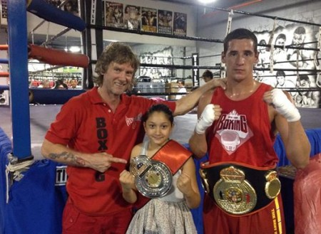 "Boxing trainer Michael ""Coach Mike"" Kozlowski and his new Champions, Michelle Cugliani and Julio Alamos."