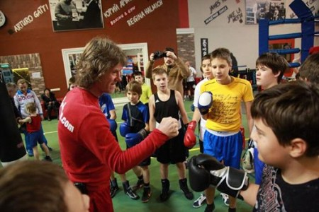 "American trainer, Michael Kozlowski, with young boxers at "" Boxing Academy ""."