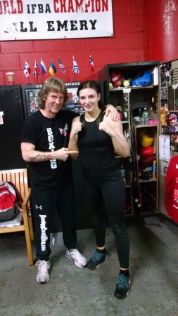 "Boxing World Champion, Christina Hammer, in office of Michael ""Coach Mike"" Kozlowski."