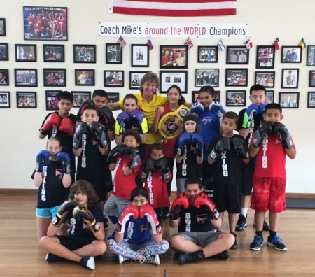 Boxing Coach Mike with his students.