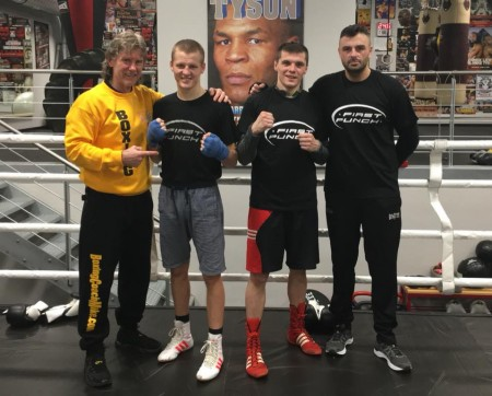 Coach Michael Kozlowski with boxers and promoter of First Punch, Chris Jan.